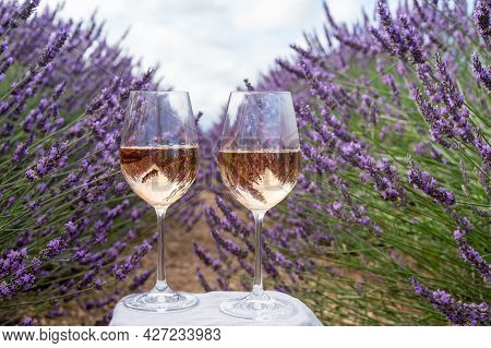 Summer In French Provence, Cold Gris Rose Wine From Cotes De Provence And Colorful Lavender Fields O
