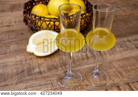 Glasses Of Cold Sweet Italian Strong Alcoholic Liquor Limoncello Made From Fresh Lemons.