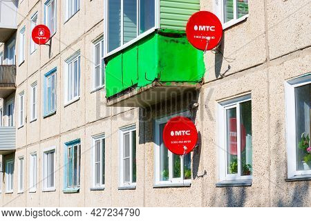Krasnoyarsk, Russia - July 15, 2021: Mts Satellite Tv Dishes On The Facade Of The Panel Residential