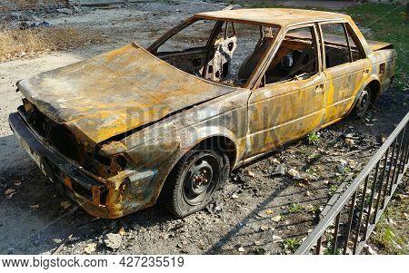 Burned Car Sedan After Street Riots. Wide Angle Shot