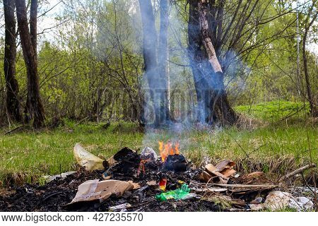 Cremation Plastic Garbage Or Trash In Open Fire. Damage To Atmosphere