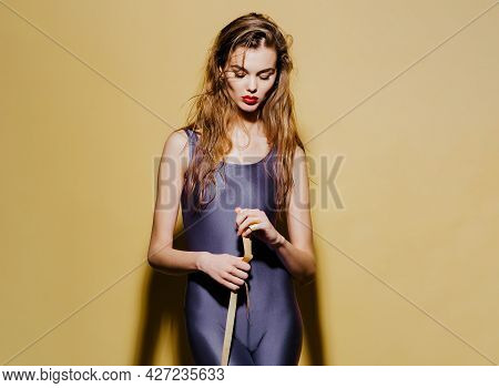 Sporty Girl Measuring Her Weist With Tape. Attractive Slim Girl With Tape-line Around Waist On Yello