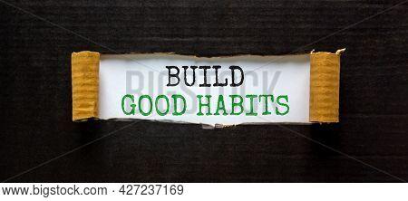 Build Good Habits Symbol. Words 'build Good Habits' Appearing Behind Torn Black Paper. Beautiful Bla