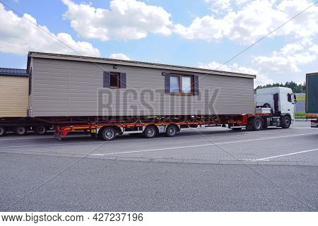 A Very Long And Wide Vehicle. Oversized Cargo Or Exceptional Convoy. A Truck With A Special Semi-tra