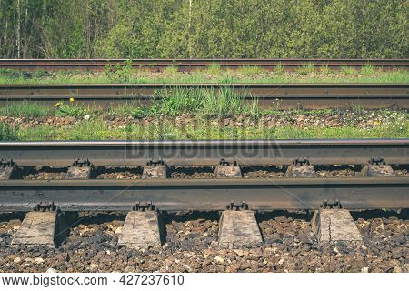 Railway Rails, Side View. Transport Background. Travel Concept By Train. Transportation By Rail. Gra