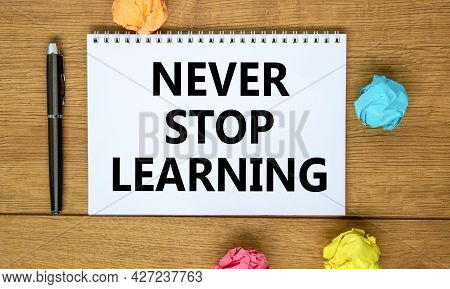 Never Stop Learning Symbol. Words 'never Stop Learning' On White Note On Beautiful Wooden Table, Col