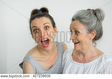 Happy Senior Mother Is Hugging Her Adult Daughter, The Women Are Laughing Together, Sincere Family O