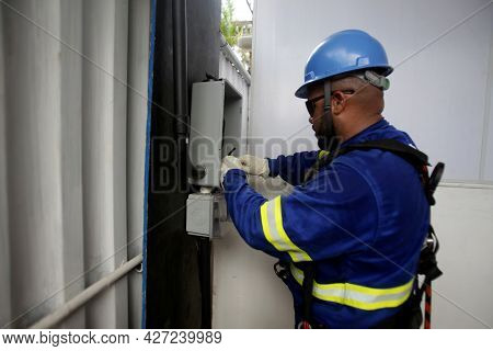 Electrician Working On Electrical Network