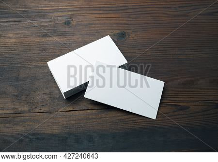 Blank Business Cards On Wood Table Background. Mockup For Branding Identity. Template For Graphic De