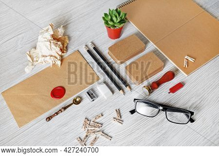 Blank Kraft Stationery Set On Light Wooden Background. Template For Branding Identity. For Graphic D