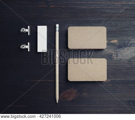 Blank Stationery Set. Kraft Business Cards, Pencil And Eraser On Wooden Background. Top View. Flat L