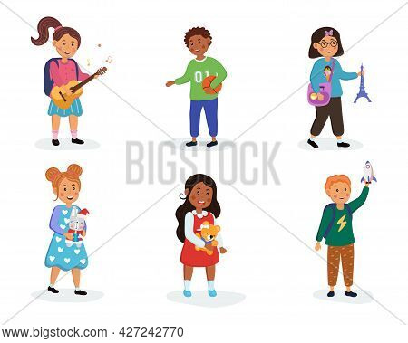 Kids In Kindergarten Play With Their Favorite Toys. Boys And Girls With A Guitar, A Rocket, A Ball,