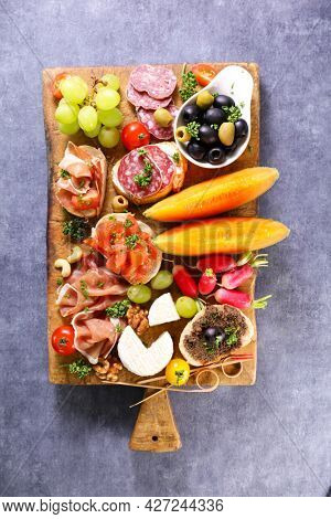 wooden board with assorted of snack and antipasto
