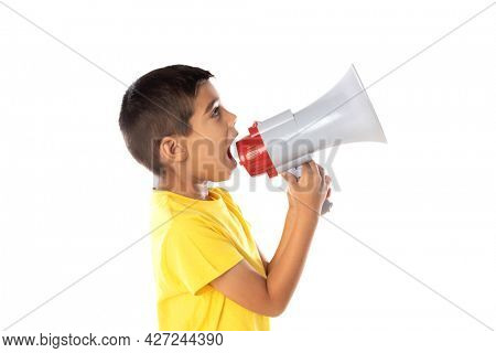 Adorable latin boy weraring a yellow t-shirt with a speaking with a megaphone isolated on a white background
