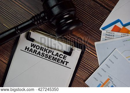 Workplace Harassement Write On A Paperwork Isolated On Wooden Table. Law Concept