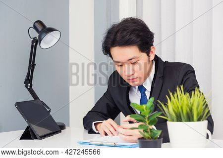Work From Home, Asian Young Businessman Video Conference Call Or Facetime He Smiling Looking To Pape
