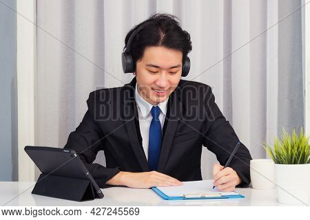 Work From Home, Asian Young Businessman Wear Suit Video Conference Call Or Facetime He Smiling Sitti