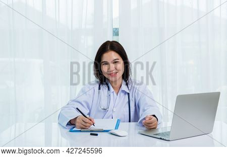Asian Doctor Young Beautiful Woman Smiling Using Working With A Laptop Computer And Her Writing Some