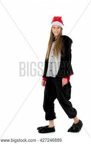Full Length Portrait Of Girl In Bat Costume. Beautiful Teenage Girl Wearing Kigurumi Pajamas Posing