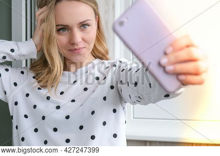 Blonde Young Girl Taking Selfie. Video Call. Online Education. Work From Home. Woman Holding Smartph