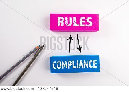 Compliance And Rules Concept. Colored Blocks On A White Background