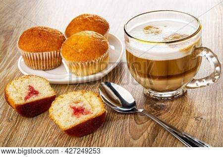 Muffins In Paper Wrapper In Heart Shape Plate, Halves Of Muffin, Teaspoon, Transparent Glass Cup Wit
