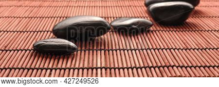 Five Hot Stones Massage Stones On A Bamboo Mat, Health Care, Aromatherapy, Header Or Backdrop