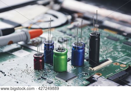 Electrolytic Capacitor Group Placed On Electronic Circuit Board