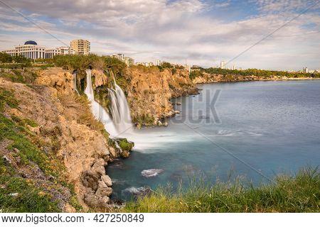 Lower Duden waterfall in Antalya, Turkey. Beautiful waterfall with the rainbow at the turkish Mediterranean sea coast