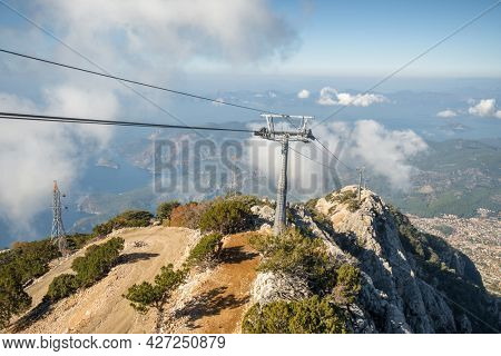 Top view of the Babadag mountain with cable car to Oludeniz and Fethiye cities in Mugla province, Turkey