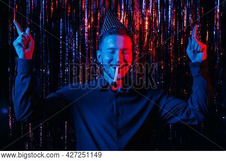 Birthday Party. Fun Celebration. Holiday Joy. Festive Occasion. Red Blue Neon Light Relaxed Happy Ma