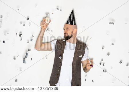 Birthday Man. Drunk Party. Holiday Fun. Enjoying Celebration. Silly Skeptic Guy Looking Glass Of Cha