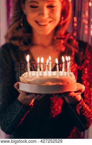 Festive Bakery. Happy Woman. Birthday Celebration. Inspired Smiling Lady Feeling Amazed Holding Cake
