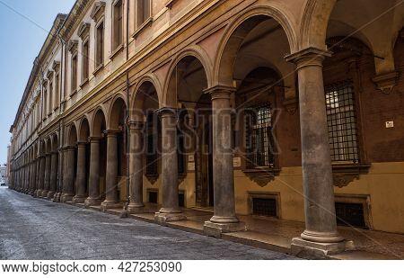 Bologna - Italy - July 3, 2021: The Arcades Of Via Zamboni, University Area, In Old Bologna City Cen