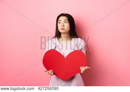 Valentines Concept. Lonely Teenage Asian Girl Dreaming About Love, Feeling Sad And Lonely On Lovers