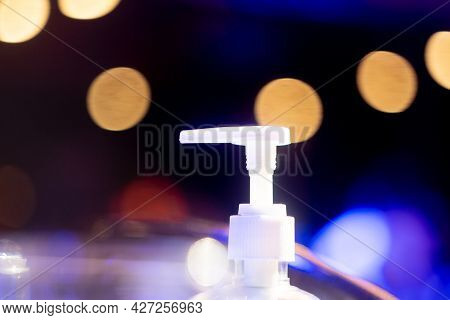 Sanitizer Bottle Nozzle With Out Of Focus Bokeh Balls Showing New Normal In Bars Clubs Restaurants P