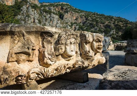 Ruins of ancient city of Myra in Demre, Turkey. Theatrical mask stone relief of ancient town of Myra in Lycia region