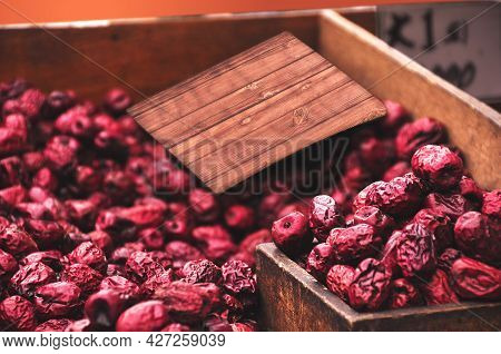 Red Fresh Dry Berries In Wooden Crate At Fresh Market. Harvesting Raspberries. Collected Berries Are