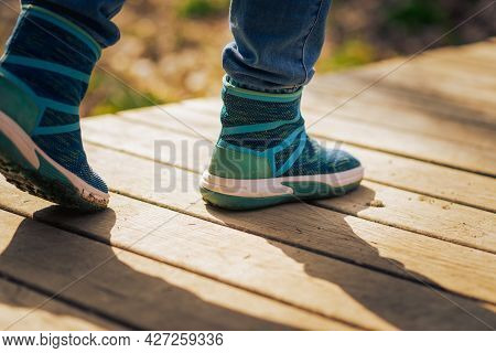 Close Up Woman Walk In To The Wild. Travel Adventure And Freedom Concept.woman Walking Outdoors, Sho