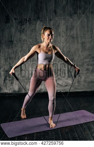 Muscular Young Athletic Woman With Perfect Beautiful Body Wearing Sportswear Exercising With Resista