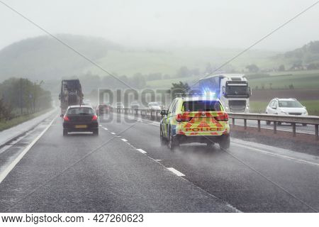 Police siren flashing blue lights driving on motorway to accident or crime scene
