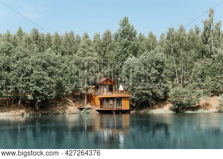 Modern Aesthetic Wooden House On The Lake. Exterior Of A Country House, Cottage On The Water Near Th