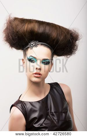 Peculiar Emotional Girl With Odd Creative Styling. Fantastic Hairdo. High Fashion