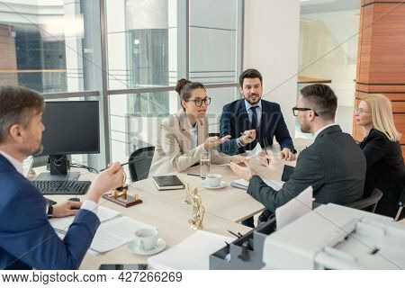 Group of business people planning work together and discussing together at the table during business meeting at office