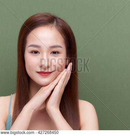 Beautiful Woman Hold Folded Palm Near Face