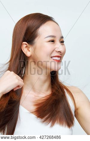 Portrait Of A Beautiful Woman With A Long Hair
