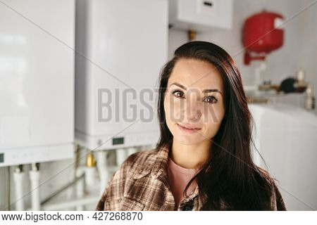 Young Caucasian brunette female looking at camera in home lavatory