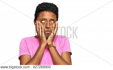 Young african american woman wearing casual clothes tired hands covering face, depression and sadness, upset and irritated for problem