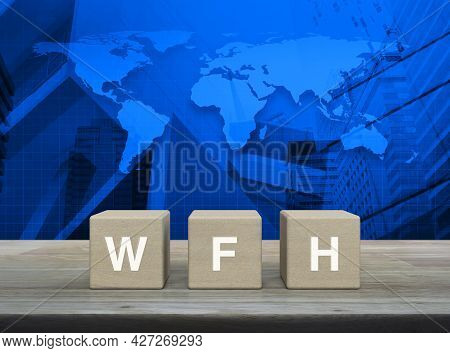 Wfh Letter On Block Cubes On Wooden Table Over World Map, Modern Office City Tower And Skyscraper, B