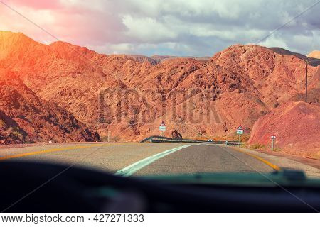 Highway Amoung Red Mountains. Sandstone In Desert. View From Car. Israel